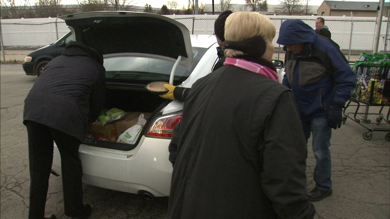 The DuPage Township Food Pantry turns into a makeshift speedway to help families move through quickly during the holiday season.