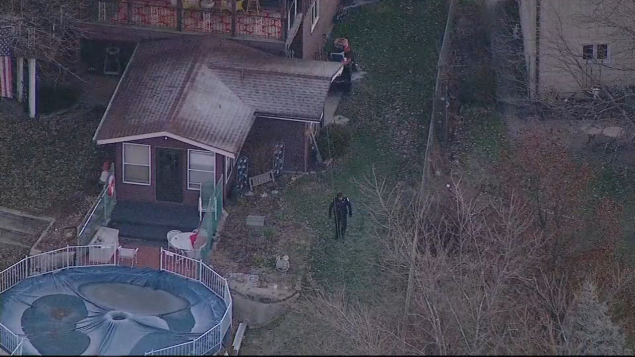 Police were seen searching the backyards of homes in Orland Park after a carjacking in Matteson Monday morning.