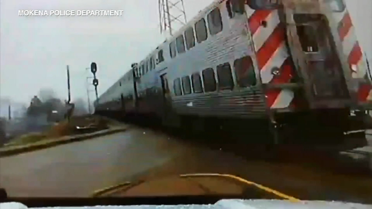 A police officers dash cam captured the moment he narrowly avoided being hit by a Metra train at a crossing in south suburban Mokena.
