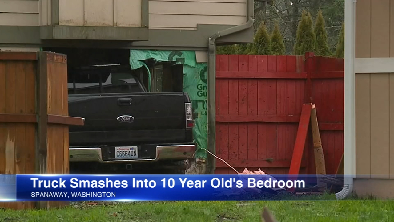 A girl, 10, is unharmed after a truck plowed into her bedroom.