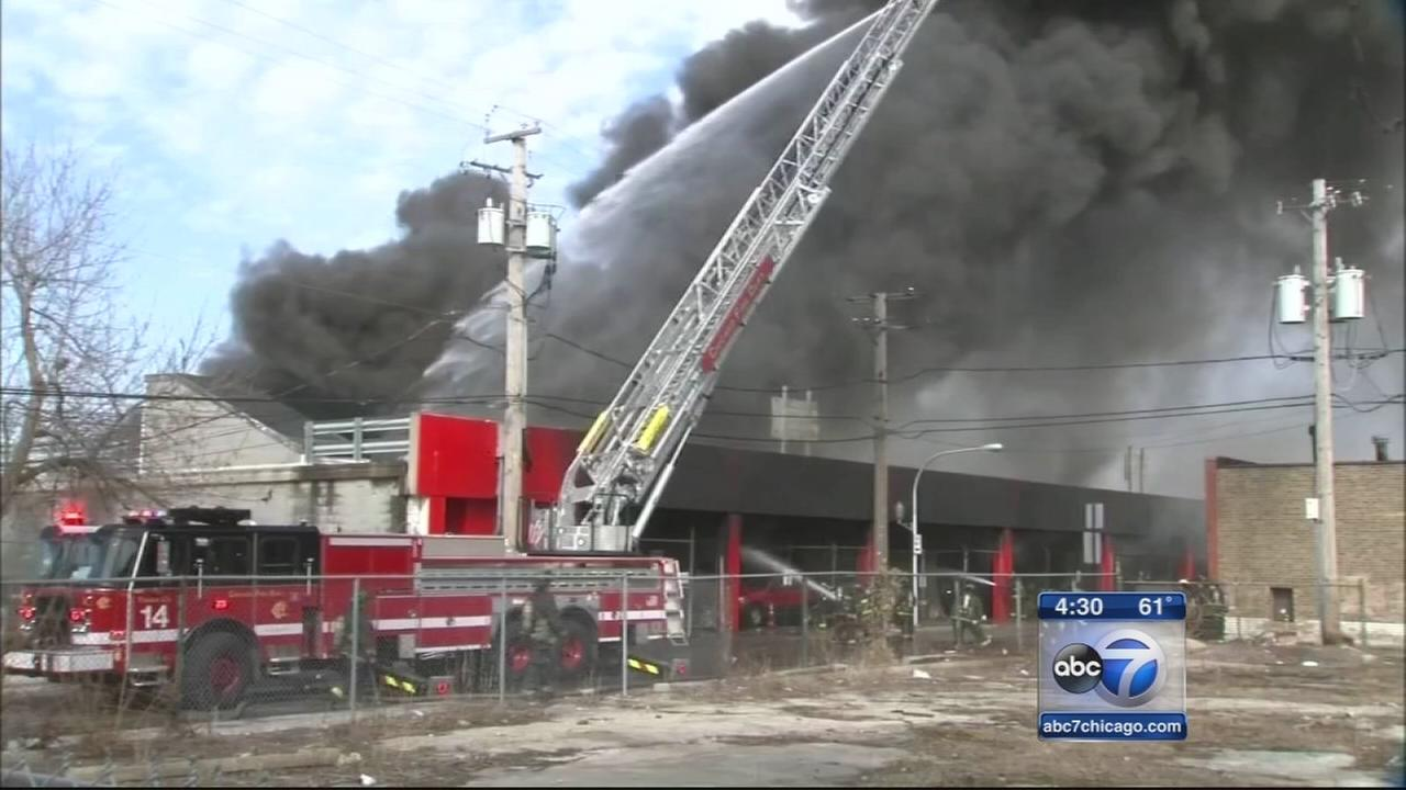 Flea market fire smolders in West Humboldt Park