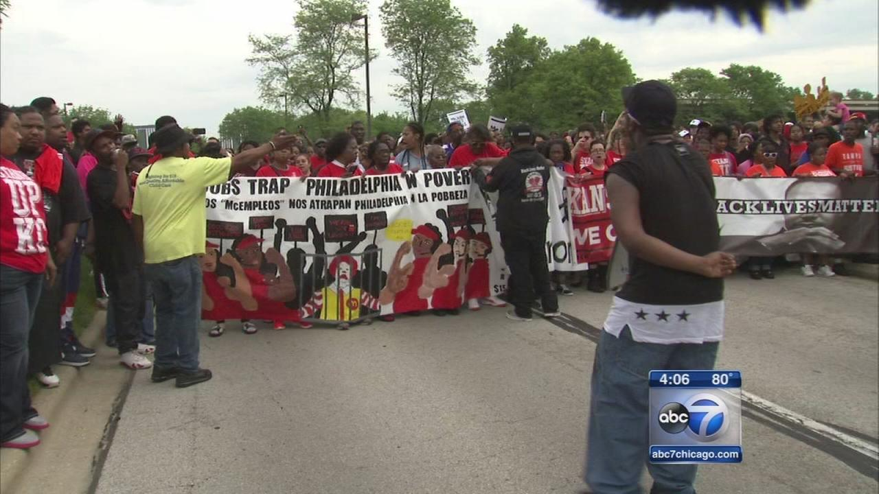 Workers rally outside McDonalds HQ, demand higher wages