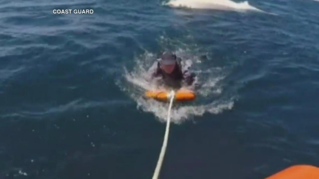 Video shows men rescued from Lake Michigan