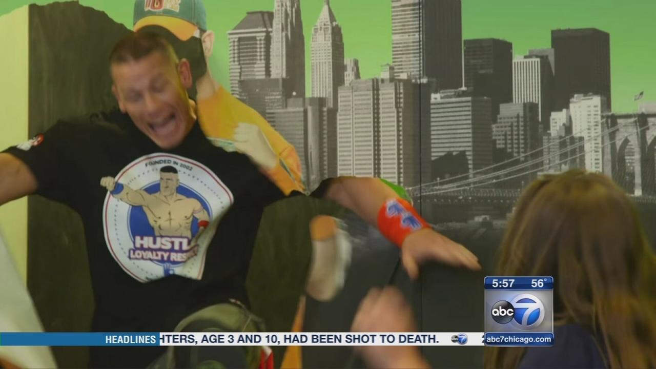 Watch: Wrestler John Cena pops out of wall, surprises fans