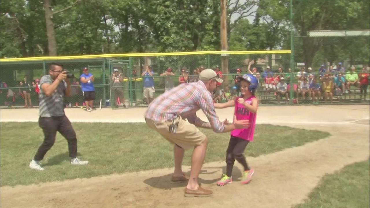 Soldier father surprises daughter at softball game