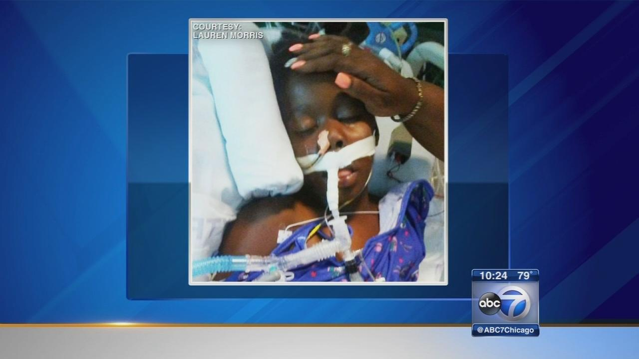 Child shot in stomach remains hospitalized