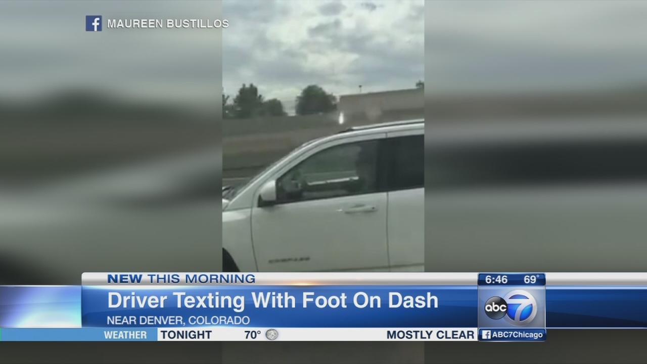 Driver caught texting with foot on dash