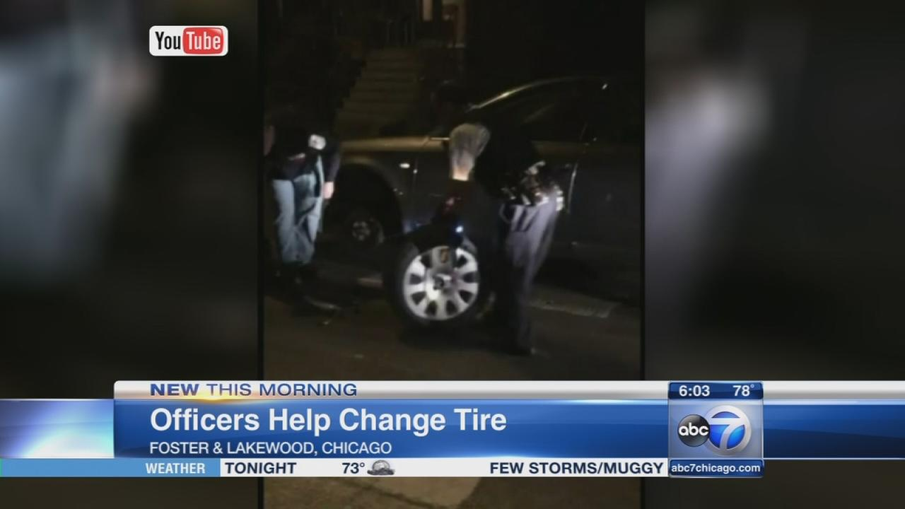 Officers help change tire