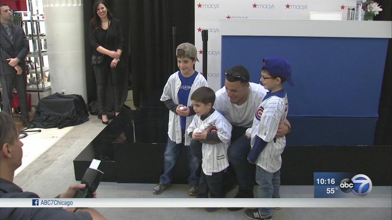 Fans line up to meet and see Cubs players