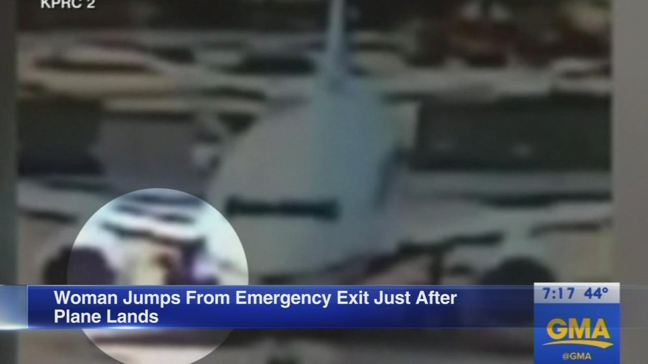 Woman jumps from emergency exit