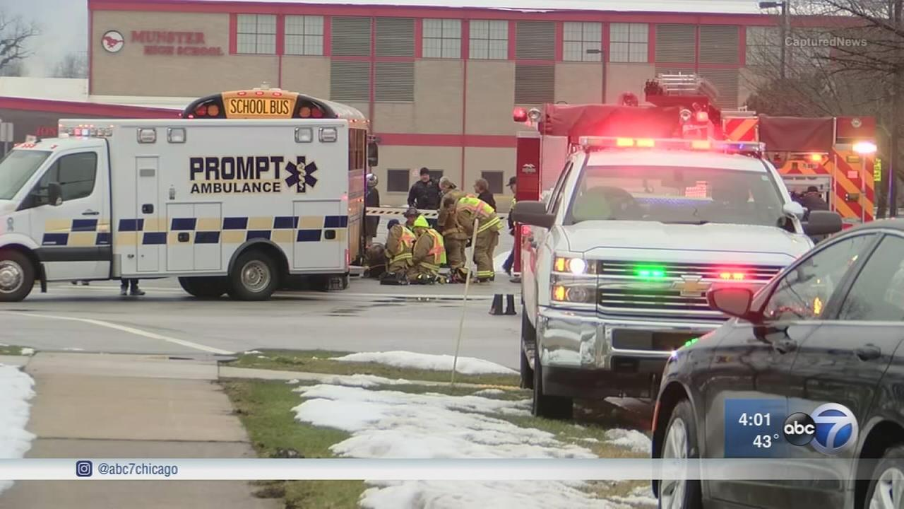 Munster High School student stuck, pinned by school bus