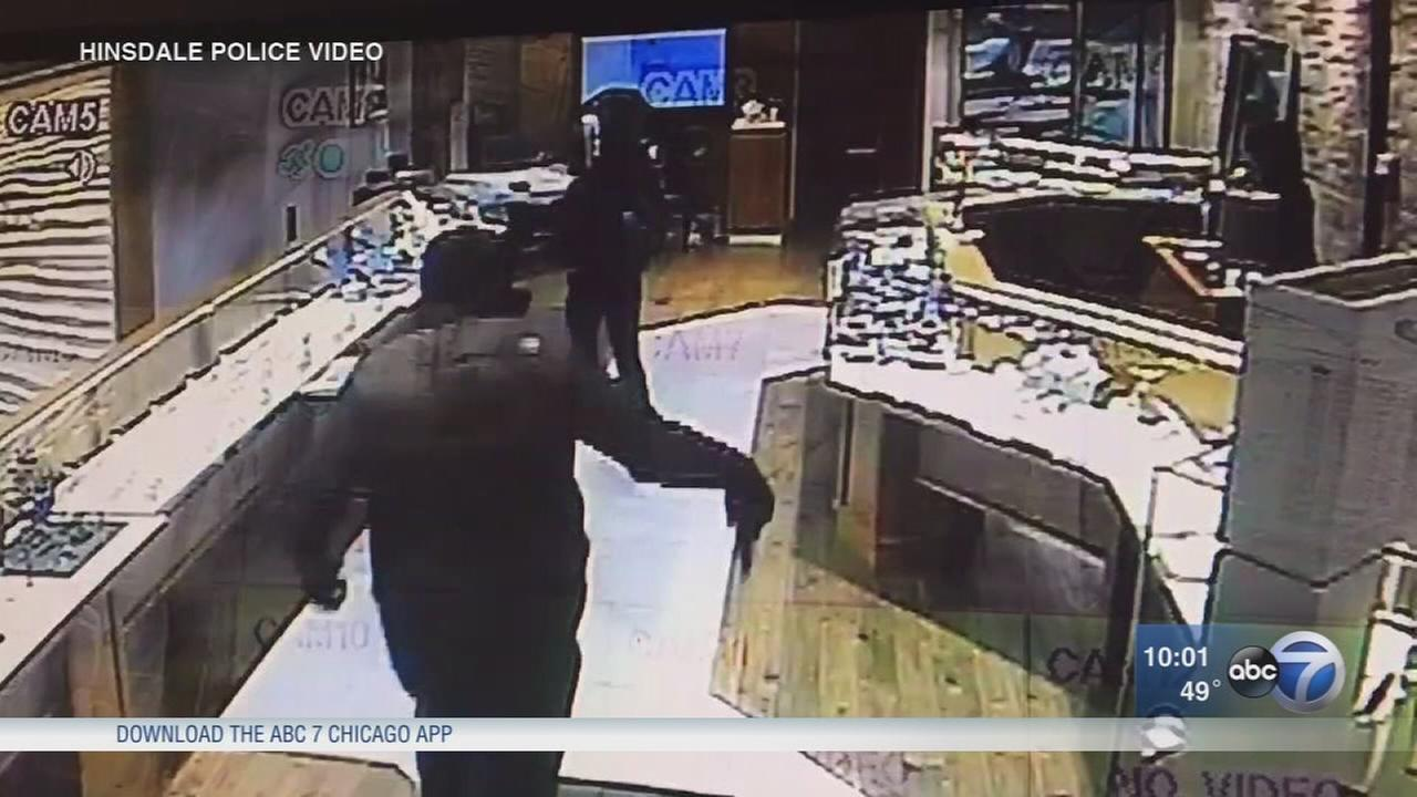 Hinsdale police are searching for three suspects in a violent armed robbery caught on camera at a jewelry store.