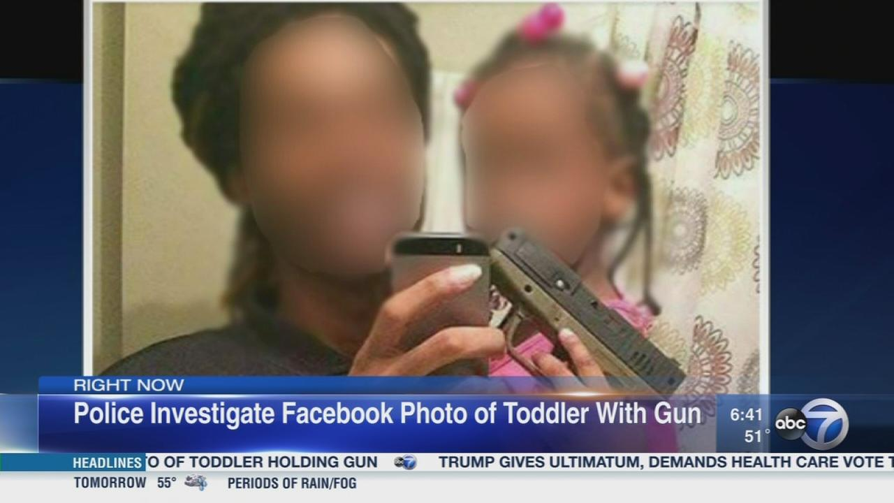 Man in photo with girl holding gun sought
