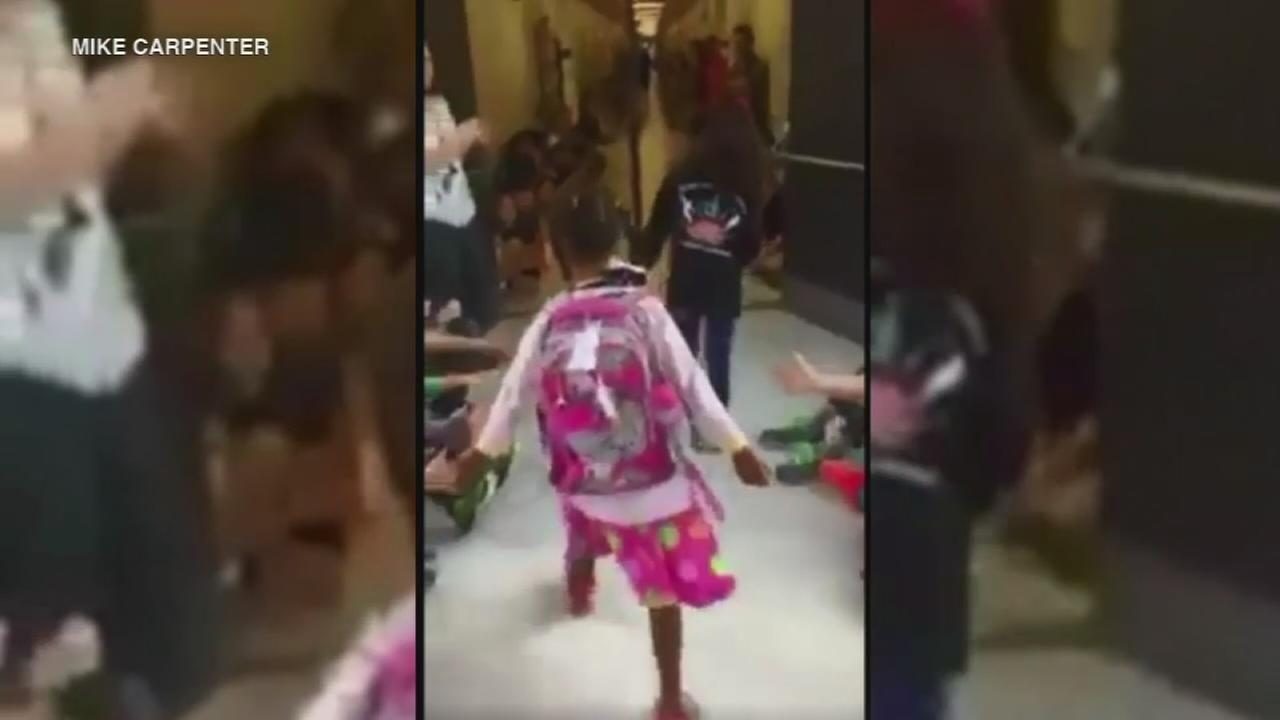 Whole school cheers as girl returns from Special Olympics