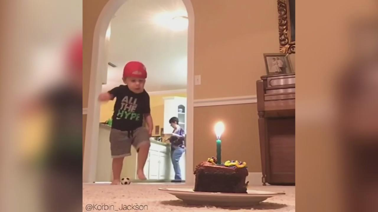 Toddler?s perfect kick snuffs out candle