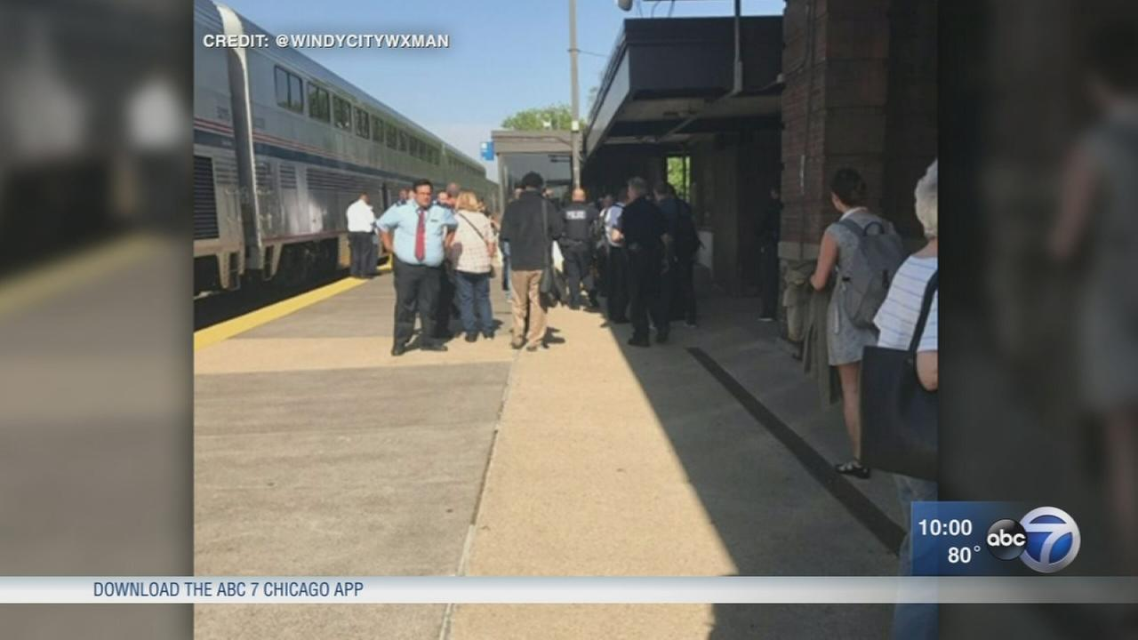 Amtrak conductor shot by passenger at Naperville Metra station, police say
