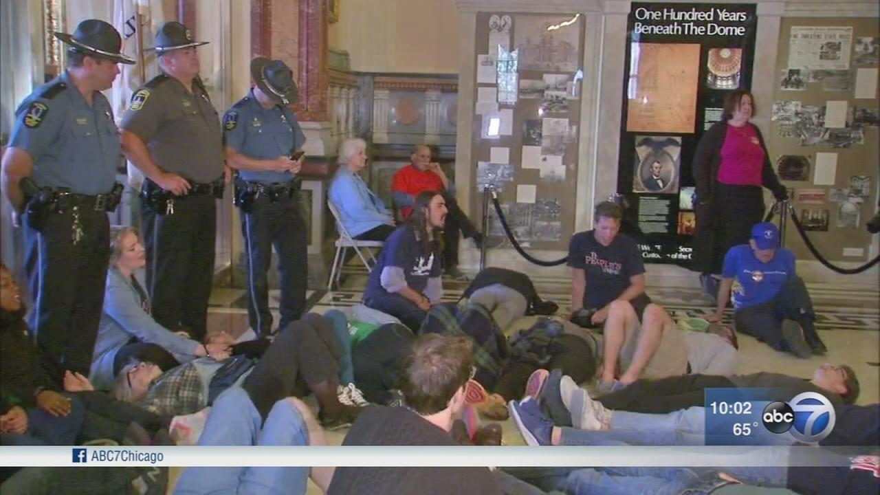 Protesters stage sit-in over budget outside Gov. Rauners office