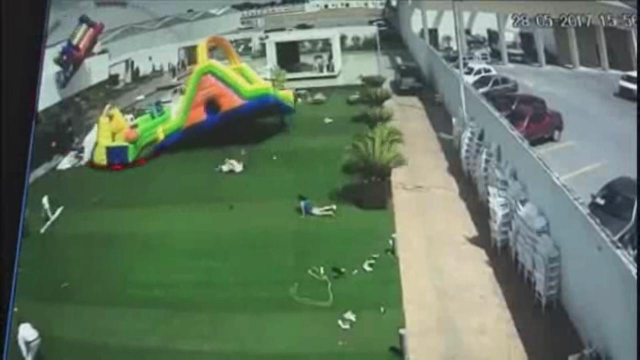4 children hurt after bouncy house swept into air