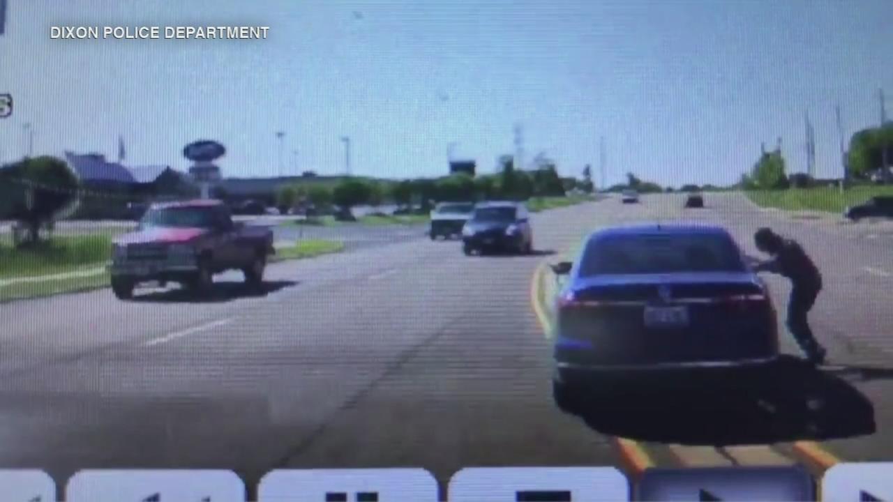 VIDEO: Man jumps into car, saves driver having seizure