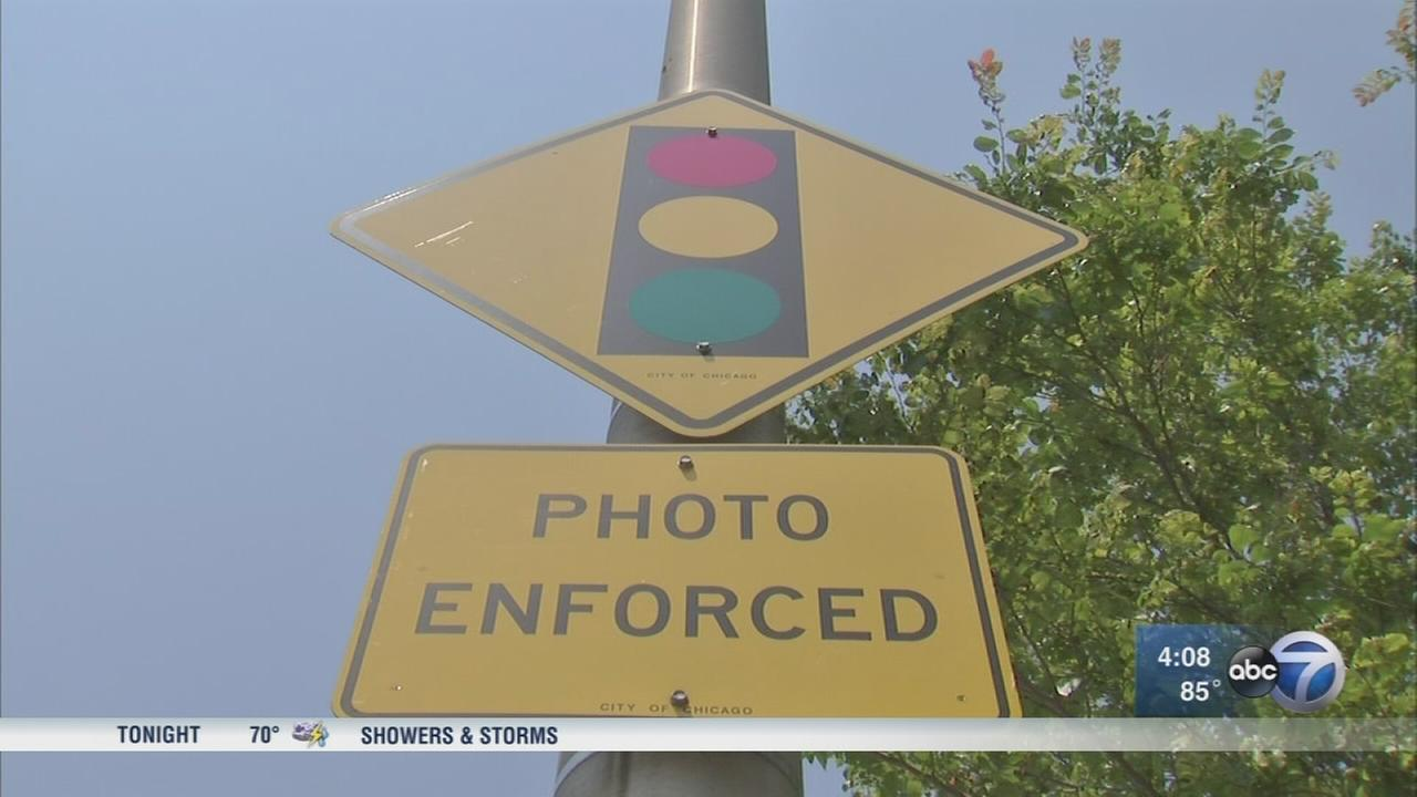 City Council approves red-light, speed camera settlement