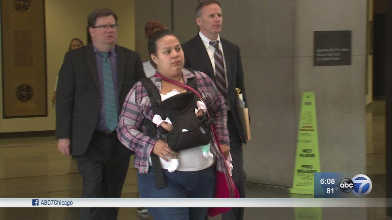Woman held while pregnant on non-violent charge appears in court