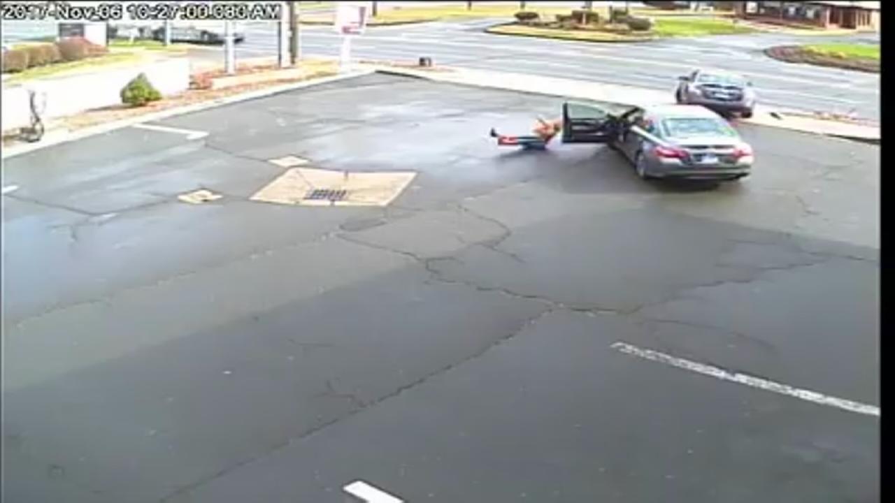 Woman dragged 15 feet in carjacking, police say