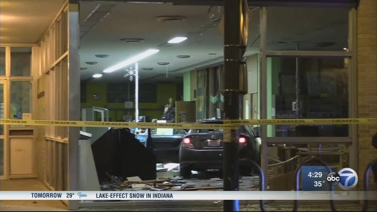 Boy, 14, shot while riding in stolen car that crashed into library