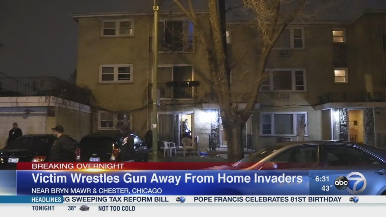Victim wrestles gun away from home invaders on NW Side
