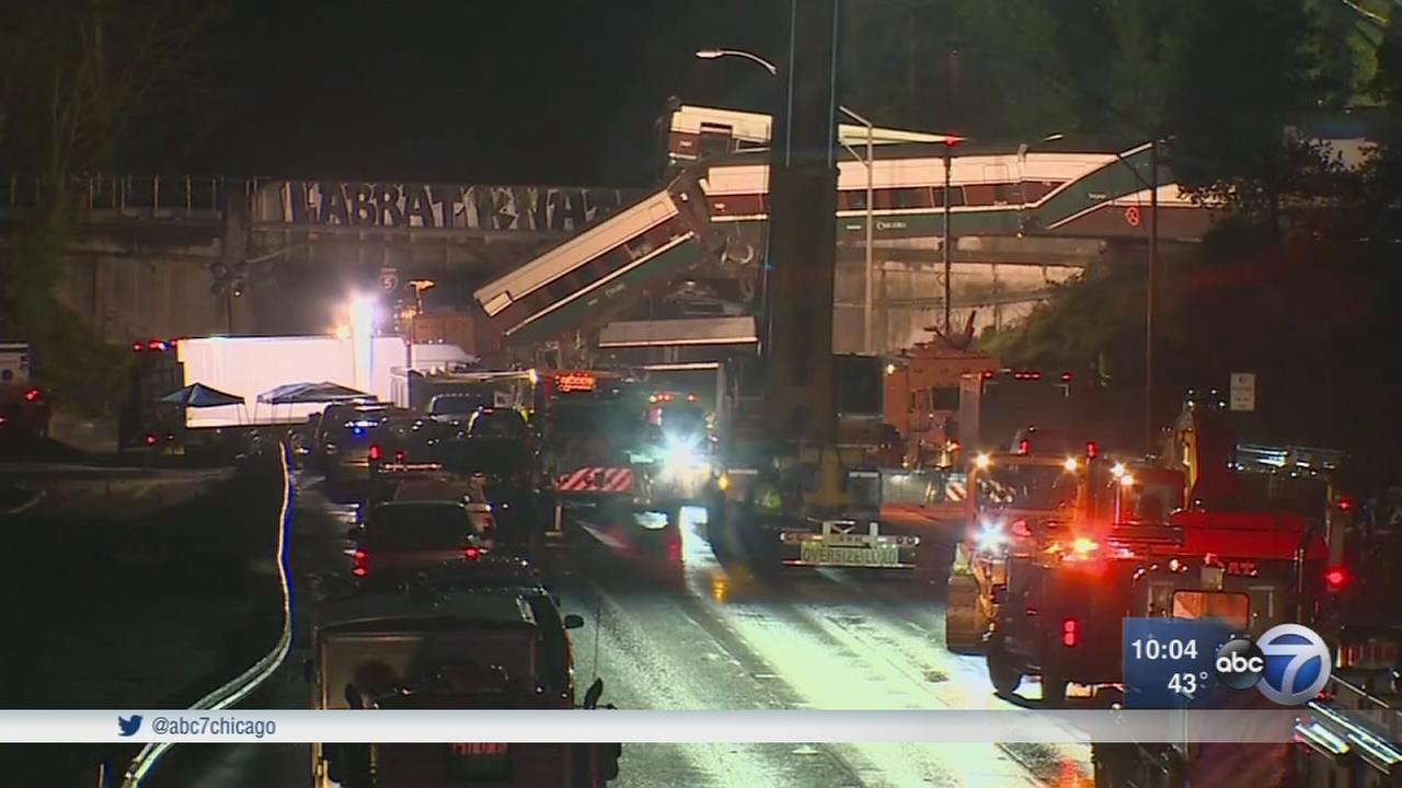 Amtrak derailment: Train car dangles over interstate; at least 3 dead
