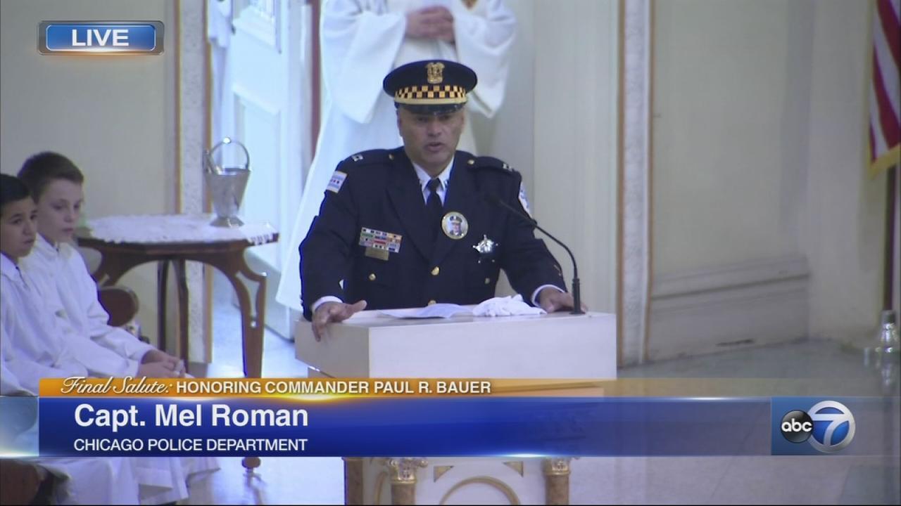 Capt. Mel Roman speaks at Cmdr. Bauers funeral