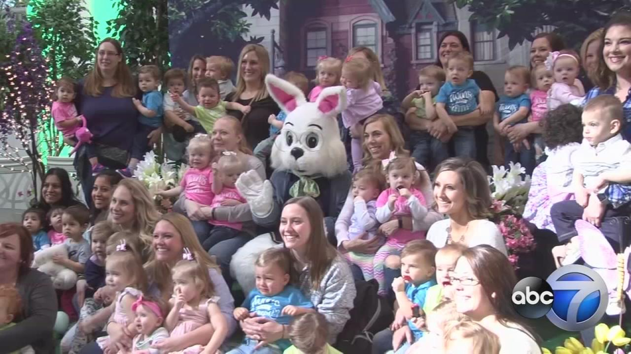 18 sets of twins pose with Easter Bunny