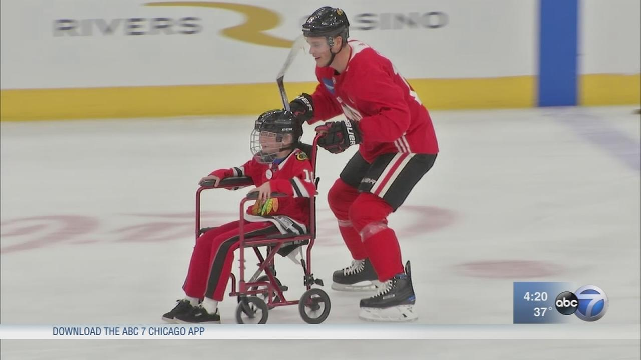 Blackhawks score smiles for 12-year-old boy with muscular dystrophy
