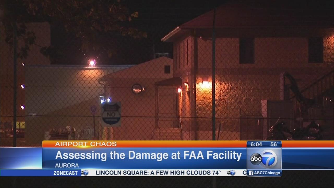 Crews assess damage inside FAA facility