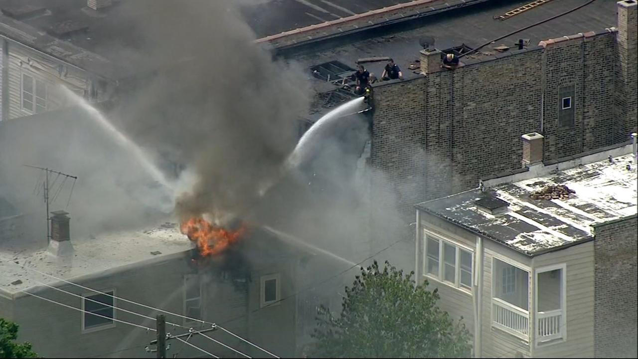 Firefighters battle Logan Square blaze