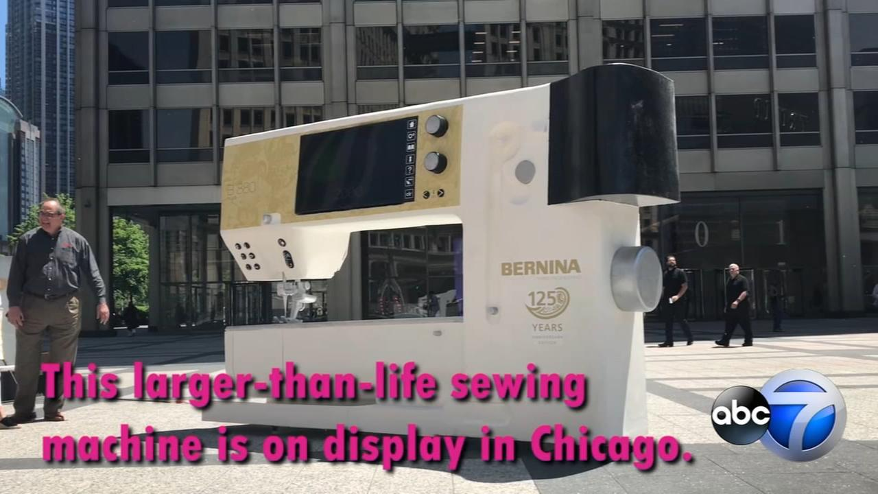Giant sewing machine on display along Mag Mile
