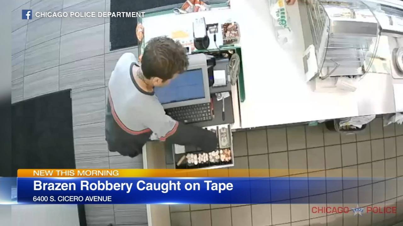 VIDEO: Robber walks around counter, grabs cash from register