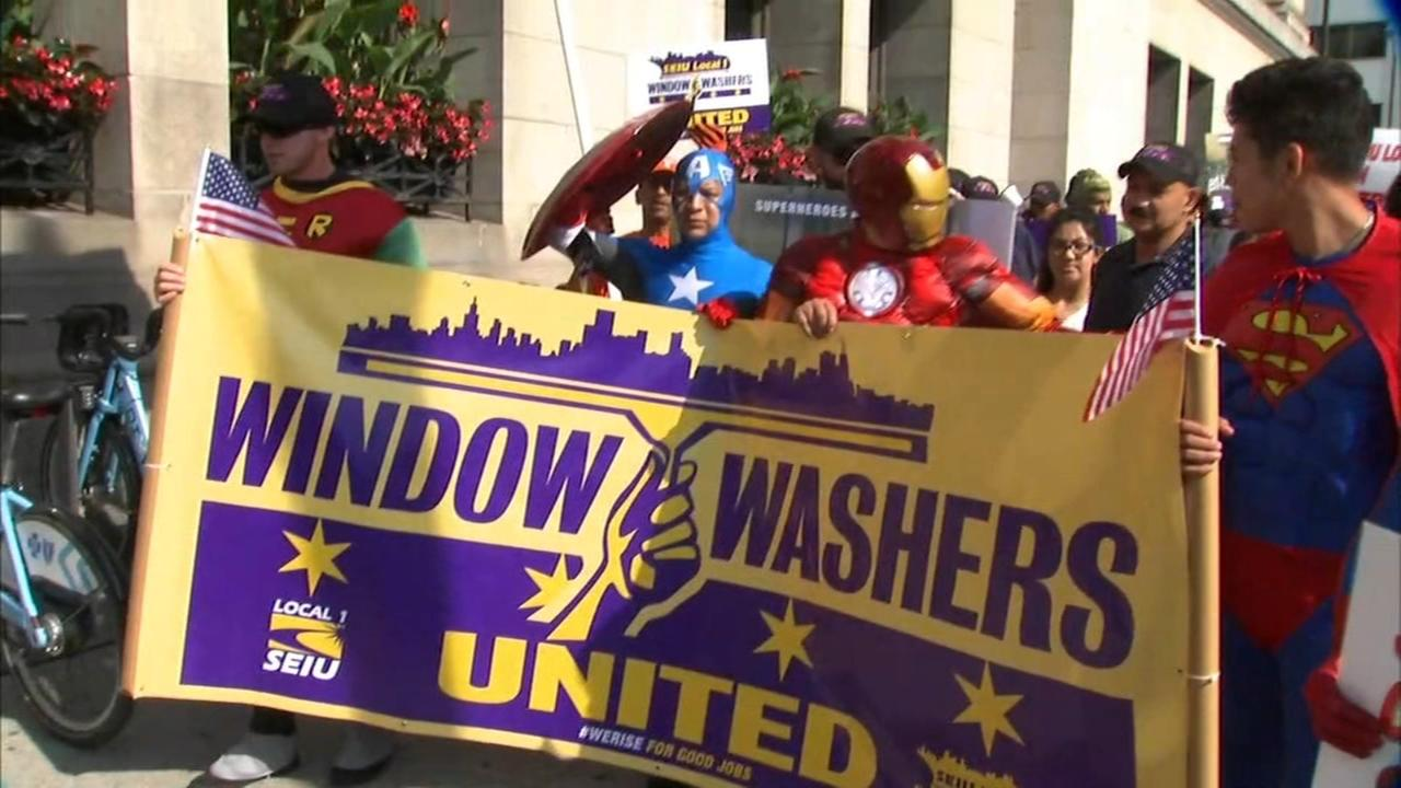 Window washers dressed as superheroes protest as strike continues