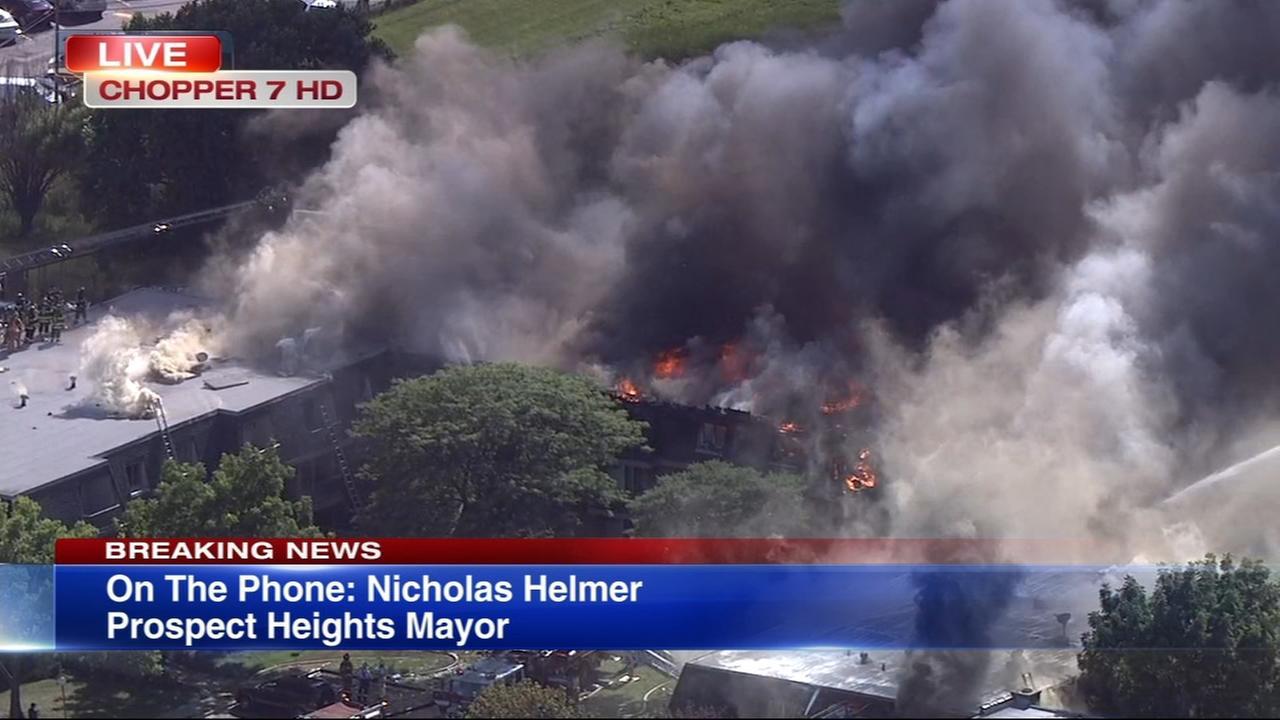 Firefighters battle massive blaze at Prospect Heights condominium complex
