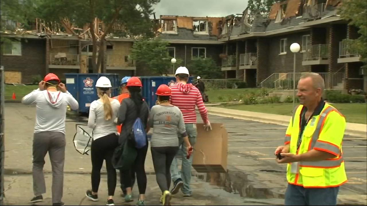Residents return to condos destroyed by fire