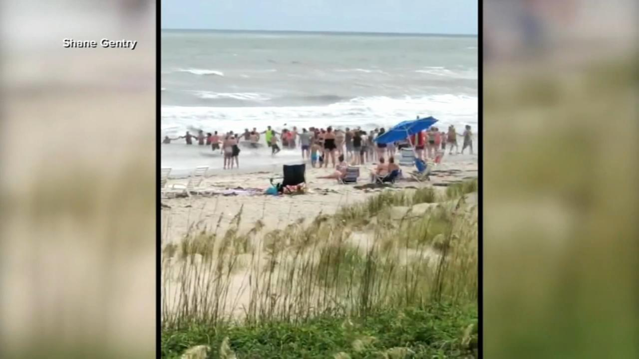 VIDEO: Beachgoers form human chain in NC to save swimmers