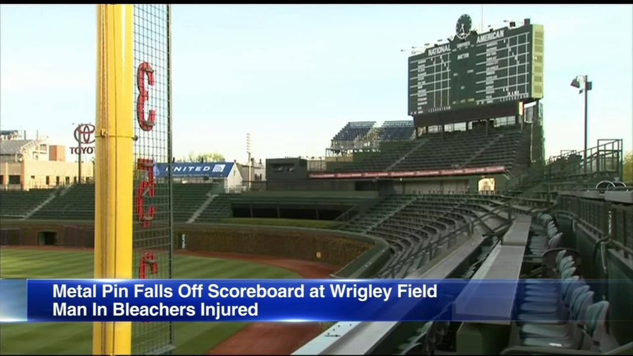 Cubs fan injured by fallen scoreboard piece