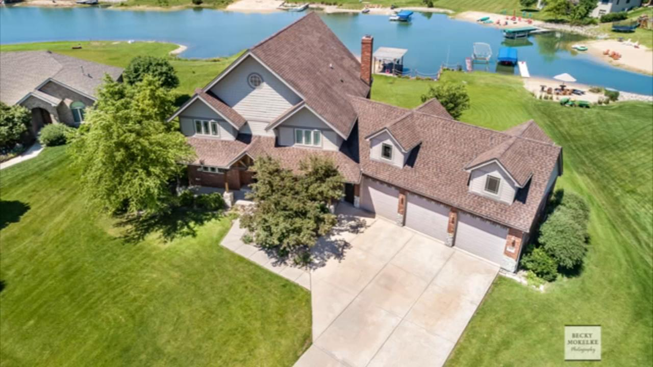 Minooka house for sale features ice rink, private beach