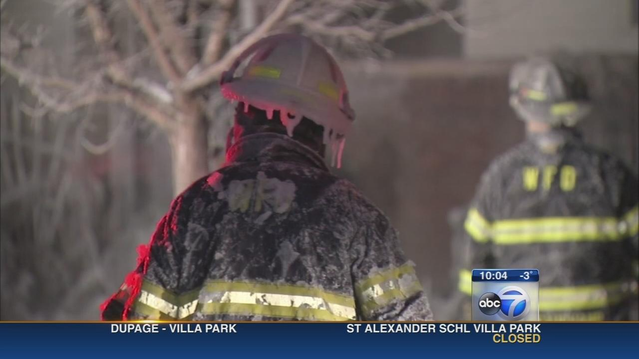 Ice-covered firefighters fight Whiting blaze