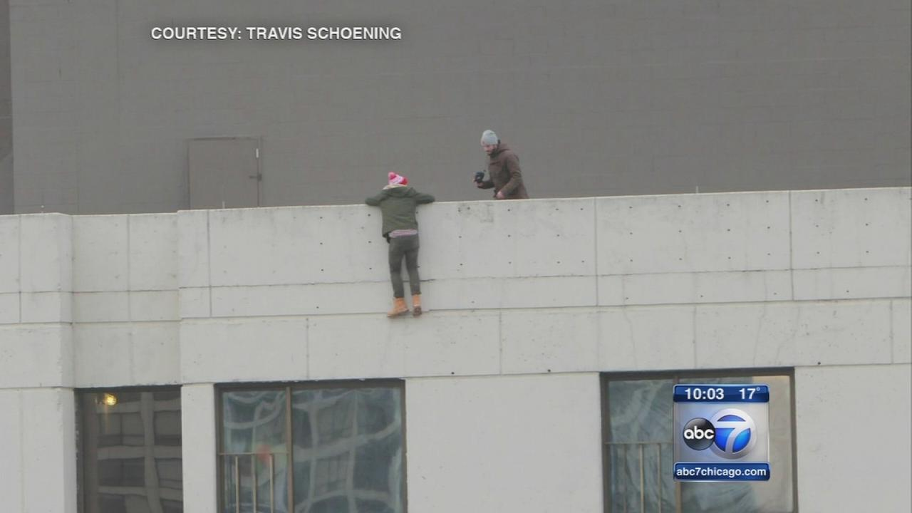 Daredevils spotted hanging from hotel