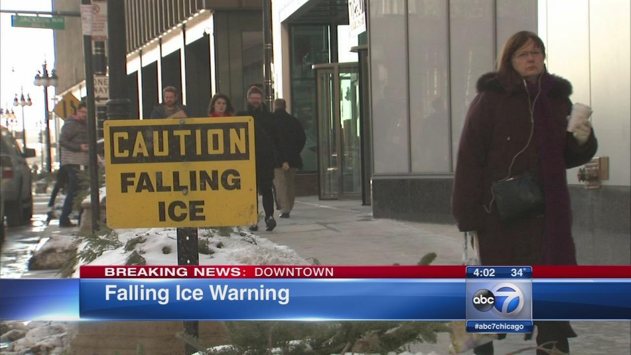 Falling ice signs out in Chicago