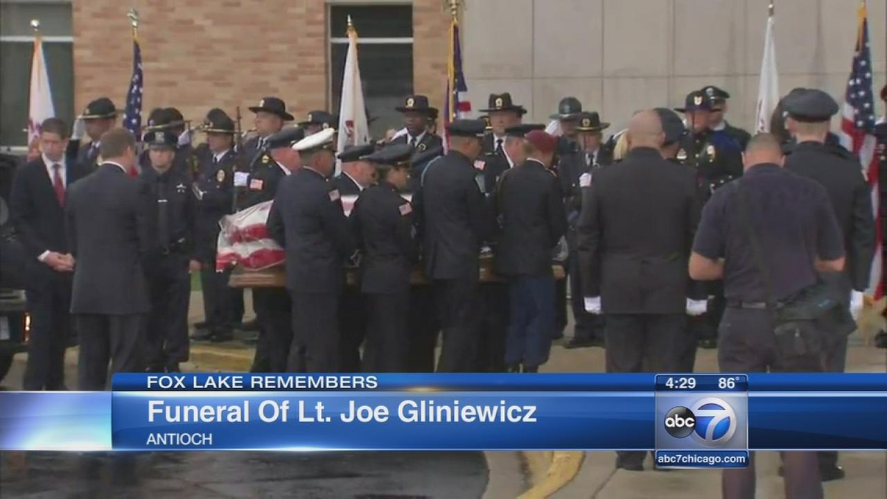 Community mourns slain police officers