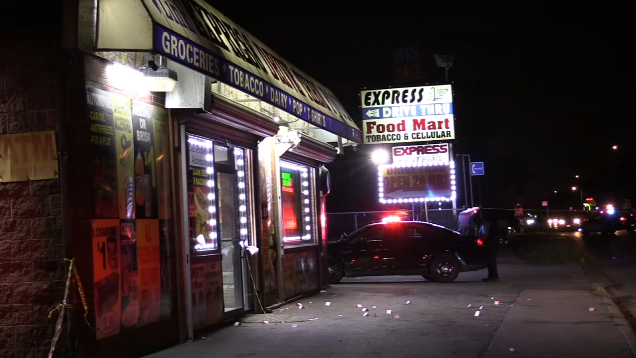 Two people were shot and killed at a liquor store in south suburban Harvey late Tuesday night. Police said their killers are on the run.