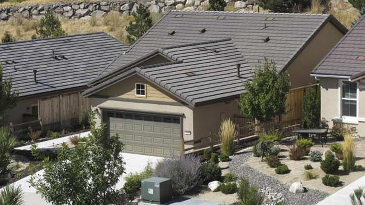 This photo shows a home that FBI agents searched Monday, Oct. 2, 2017, in Reno, Nev.