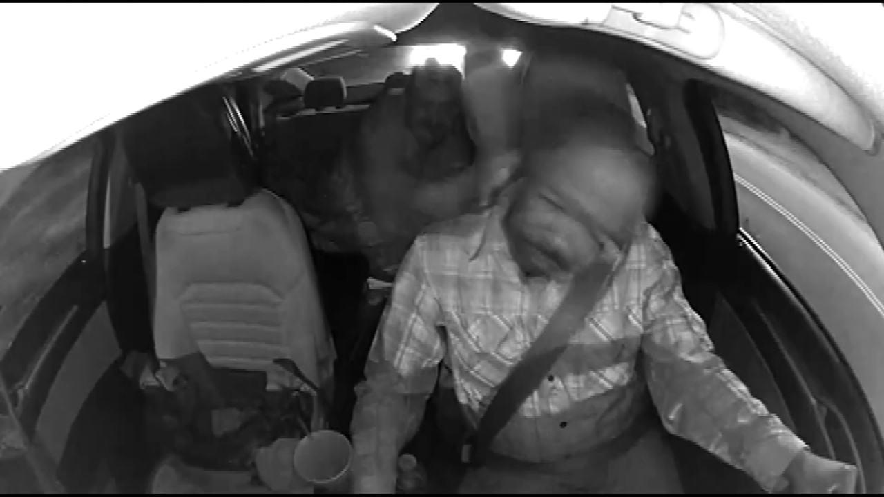 Shocking video shows vicious assault as the driver passes out and car careens into a house.
