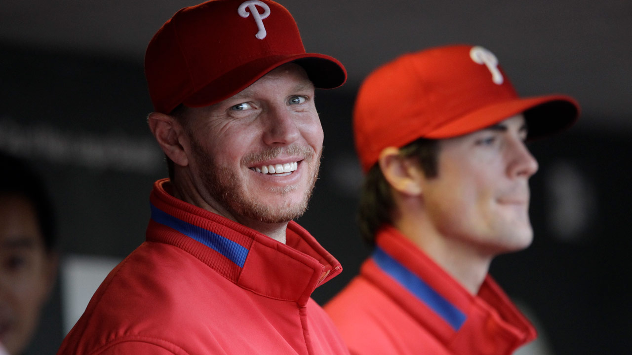 Philadelphia Phillies starting pitcher Roy Halladay smiles with Cole Hamels in the dugout in San Francisco, Tuesday, April 27, 2010.